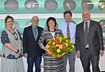 Petra Haas receives award for 40 years of loyality to OKW
