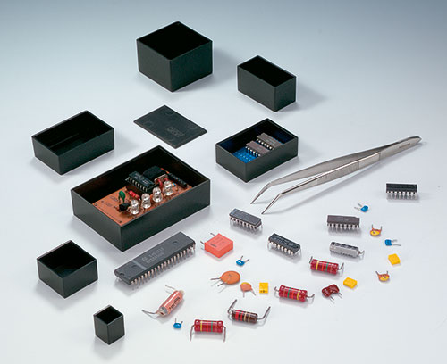 Boitiers pour le coulage de composants électroniques